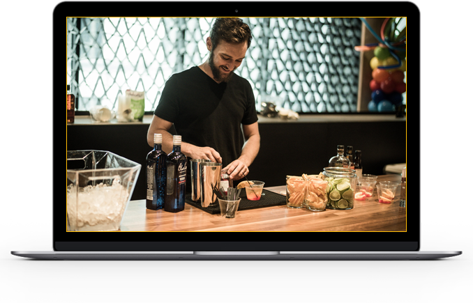 Image of bartender making craft cocktails at a business event catered by Office Libations
