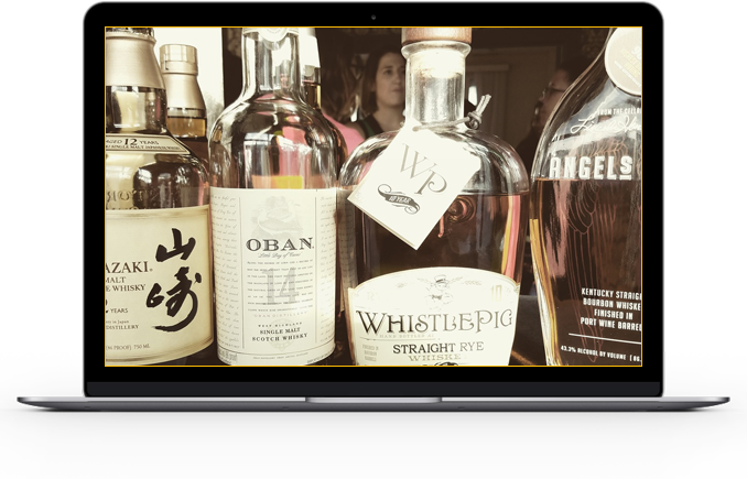 Image of high-end whiskey like Oban and Whistlepig supplied and delivered by Office Libations.