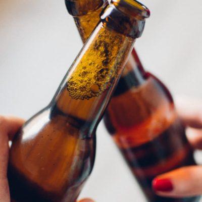 Image of two people enjoying beer