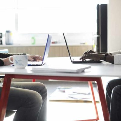 Image of two people working in an office