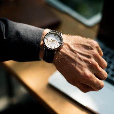 Image of a person checking their watch