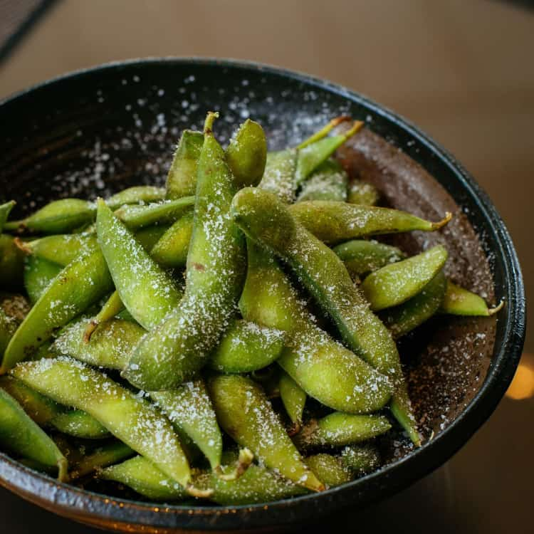 image of edamame as a healthy snack for work